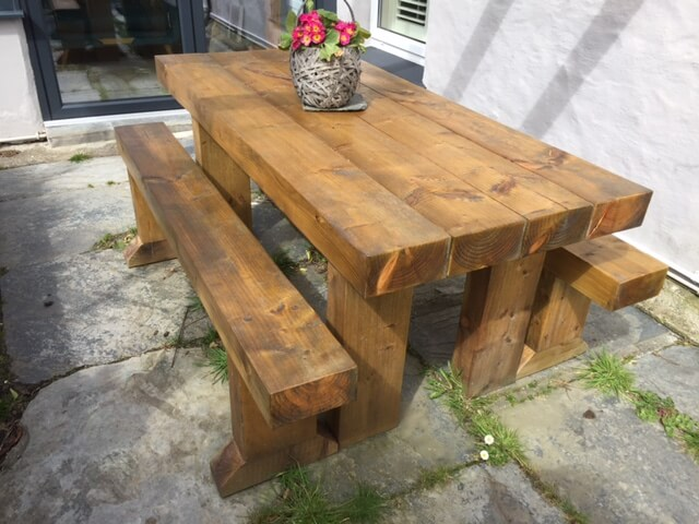 A garden bench made from reclaimed railway sleepers.